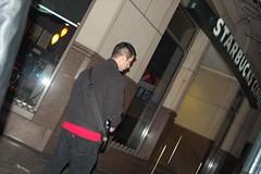 DSC_0354.JPG (Andrew Feinberg) Tags: man building coffee shop walking outside guard security front starbucks sxsw scoble geico facebook caveman darkened