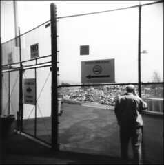 Exit fence, Oakland Coliseum (westkauai) Tags: california blackandwhite bw fence square oakland holga d76 exit redfilter oaklandcoliseum gelatinsilverprint sfx200