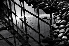 pure bliss (digitalsparks) Tags: light sun white black water lines reflections rocks hull bliss blacknwhite pure eastpark digitalsparks