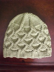 Wavy cabled lace cap (No Knit Sherlock!) Tags: hat knitting cableslace superninjaknittingpowers