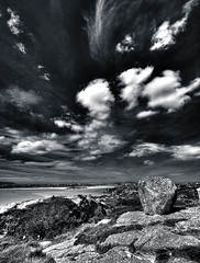 Big rock (Ian Humes) Tags: ireland sea summer blackandwhite bw seascape beach water clouds canon landscape blackwhite coastal canon350d biancoenero blancinegre countydonegal noireblanc seasunclouds landscapesshotinportraitformat