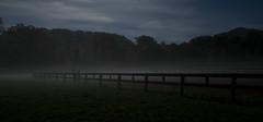 Night Pasture (jon_beard) Tags: longexposure trees sky mist mountains fog night clouds fence dark post smoke