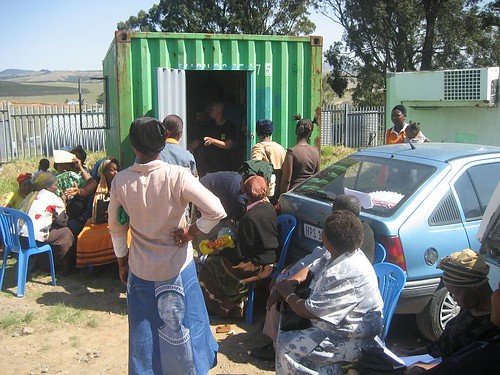Village health workers waiting to get their nutrition parcels outside the Hlomelikusasa container.