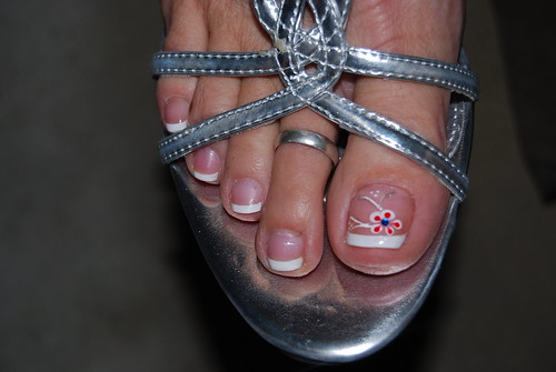 French pedicure with white tips and flower