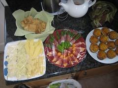 cheese platter, pita chips, asparagus & cantaloupe in prosciutto, pumpkin muffins