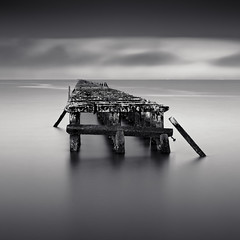 Dominos (~ superboo ~ [busy busy]) Tags: longexposure morning bw water clouds marina bay berkeley pier cloudy dominos remains remnants maxxsmart