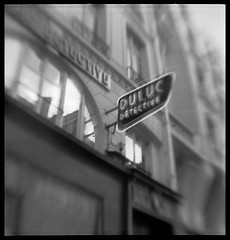 Paris, April 2008 (robert schneider (rolopix)) Tags: blackandwhite bw blur paris france 6x6 film monochrome sign mediumformat square europe neon kodak eu april brownie hawkeye expired 2008 vp outdated detective 620 bhf browniehawkeyeflash flippedlens outofdate verichromepan duluc dulucdetective kodakvp 120620 fixedshadows 1erarr believeinfilm