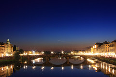 Florence by night (Pawel Boguslawski) Tags: bridge sky italy night plane canon river stars lights florence firenze 5photosaday 40d