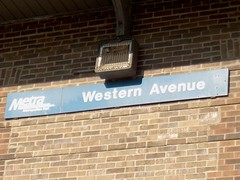 The station sign on the east side of the Metra Western Avenue commuter rail station. Chicago Illinois. October 2006.