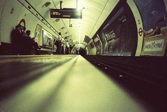 ratseye (benbenbenbenben) Tags: london film station angel night underground lomo lca xpro lomography crossprocessed waiting kodak tube platform 200 groundlevel elitechrome wp explored ratseye chinscraper