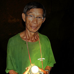 Our friendly cave guide (Bn) Tags: flashlight laos stalagmite vangvieng stalagmites undergroundriver pitchblack undergroundtunnel batterypack lekkerding diamondcave limestonecave slipperyrocks kneedeepinwater slipperymuddycave enteringbybearfeet excitingadventure diamondcaveandgoldmine friendlycaveguide muddywalls goodthrill slowlycreepingalong tunnelsbarelyfitme spidersandbatts jumpingintheundergroundwater