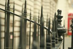 Telephone Box (_nejire_) Tags: street uk red england black macro london canon fence eos kiss iron bokeh box britain telephone explore 60mm railing railings telephonebox 10am 10faves nejire 400d eos400d kissx fave10 platinumphoto mhashi nearcanonstreet 449317g0am 6311417g9am