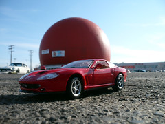"A ""Ferrari 550 Maranello"" at Montreal's ""Big Orange"". (Steve Brandon) Tags: city urban canada macro cars scale car fruit architecture geotagged toy restaurant model parkinglot automobile montral quebec bokeh montreal fastfood landmark ferrari 124 qubec dome kiosk suburb autos roadsideattraction automobiles ville toycar sportscar voitures modelcar maranello 550 tmr stationnement exoticcar  maisto  orangejulep italiancar  decarie  gibeauorangejulep   thebigorange ferrari550 townofmountroyal  ferrari550maranello ferrarimaranello autoroutedcarie dcarieexpressway decarieboulevard boulevarddcarie  dcarieboulevard  dcarieautoroute 7700boulevarddcarie"