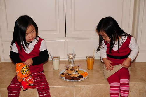 Whoo, we're tuckered out after making that Santa plate, better have a few restorative cheetos