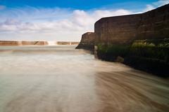 Motion. (chillie 63) Tags: ocean longexposure sea sky motion beach wet water clouds pier seaside sand waves filter hoya nd8 chillie63