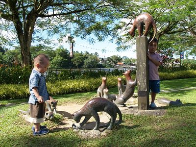The boys with the cat statues