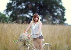 Passing of a Sunny Afternoon (sarahshootspeople) Tags: flowers summer tree field grass bike jordan