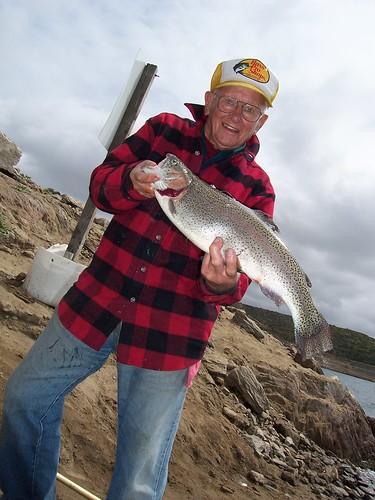 Fisherman shows off his catch at Diamond Lake near Hemet, California