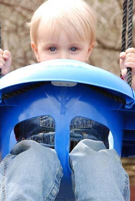 owen peeks over swing