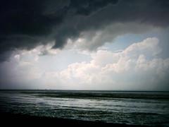 The storm (dididumm) Tags: storm sunshine clouds germany horizon wolken northsea ostfriesland distance horizont sonnenschein sturm niedersachsen lowersaxony entfernung krummhrn upleward