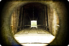 The Light at the End of the Tunnel (Kd Reinhold) Tags: old family vacation texture beauty picnic dam 1800s july coveredbridge oldmill 2008 daytrip southernmissouri delapidated fallingapart rickety burfordville fourthofjulyweekend oldestcoveredbridgeinmissouri