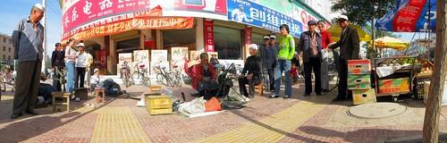 Street-side shoe repair in Huini, Gansu Province, China