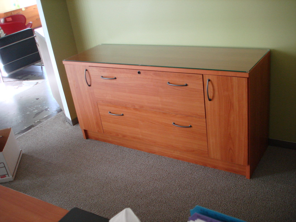 Four cherry wood credenzas