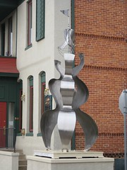 "Title: ""Between Earth and Sky""Sculptor: Mac GimseAccessible to Public: yes, outdoorsLocation: Lampe Law Group, 105 E. 5th StreetOwnership: artistMedium: stainless steelDimension: 13 feet highProvenance: artistYear of Installation: 2008Physical Condition: good"