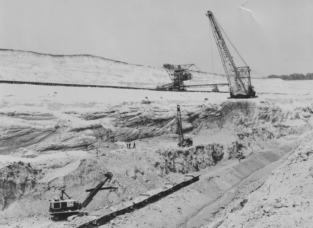 Dragline and Wheel Excavator removing Overburden to get at the Bauxite ore, MacKenzie, British Guiana