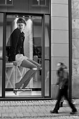 Seducing from the window (Eliseo Oliveras) Tags: life street city people urban blackandwhite bw woman white black blanco germany blackwhite europa europe negro streetshots streetlife bn advertisement alemania bremen eliseooliveras eliseooliveras