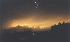 Storm over Interstate 430 (SnapShotStar) Tags: sunset orange cloud storm rain sign clouds highway freeway daytime arkansas thunderstorms 430 severeweather orangeskies nowthatssky thecloudappreciationsociety 10millionphotos arkansasthunderstorms