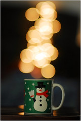 A Warm Cup of Holiday Bokeh (Extra Medium) Tags: cup coffee snowman bokeh 85mmf14d holidaybokeh bokehbubbles thewanderlust firstof4cups caidenscup wishicouldsaythiswasntsetupbutthistookmelike25minutestogetright
