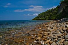 Bay (Karmen Smolnikar) Tags: sea sky beach nature water bay rocks slovenia slovenija fotocompetitionbronze fotocompetitionsilver yourwonderland