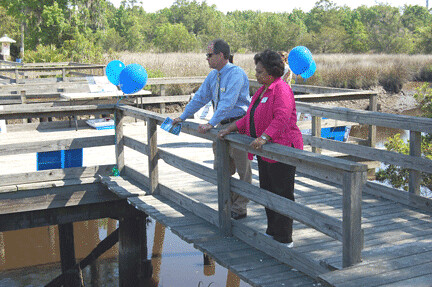 Ricky Sweat, Area Director in Baxley Georgia, talks to Georgia State Director Shirley Sherrod at the Georgia Earth Day celebration in Riceboro. The project announced by USDA will remove will remove contaminants from local rivers and streams.