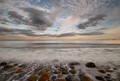 stone beach impressions (H o g n e) Tags: ocean longexposure sea summer sky cloud seascape motion beach water norway rock stone clouds landscape evening coast landscapes carved solitude waves seascapes wind dusk horizon smooth shoreline wave glacier erosion pebble shore silence glaciers pebblebeach geology oslofjord archipelago breakingwaves carvedstone carvedrock smoothwater smoothsurface smoothstone slagentangen bildekritikk smoothrock pprowinner silkwater