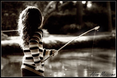 Gone Fishing (Alan Mezzomo) Tags: light lake fish luz girl sepia d50 geotagged lago 50mm kid fishing nikon child explore criana menina pesca pescaria pescando camilly explored