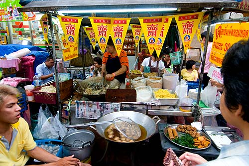 Frying up vegetarian noodles on Thanon Yaowarat during the annual Vegetarian Festival, Bangkok