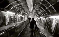 oxford circus - 12:30 pm (chirgy) Tags: london underground vanishingpoint fuji escalator tube scan pointandshoot analogue oxfordcircus goingdown cn400 pentaxespio120mi fullofnarrativepromise