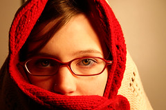 38; Defrosting. (Sara. Nel) Tags: cold glasses bigeyes eyes freezing piercing greeneyes blanket warmingup redandwhite defrosting afghangirl inmybedroom 365days daythirtyeight flickrsistr 365nov08