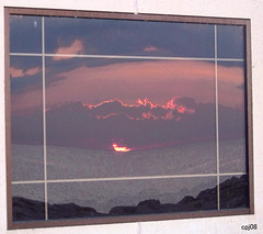 Sunrise in Glass (cphilruns over a quarter million views) Tags: red reflection window water glass sunrise gold rocks framing