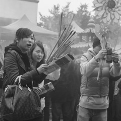 Praying for good luck. (ndnbrunei) Tags: china blackandwhite bw 120 6x6 tlr film rollei rolleiflex mediumformat square hongkong kodak chinesenewyear bn mf kodakbw400cn rolleicord bw400cn classicblackwhite rolleigallery ndnbrunei