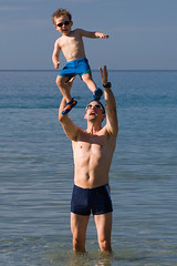 Whenever He Runs Out Of Ideas He Throws His Son Around (Prozac74) Tags: sea italy beach sunglasses fun jump sand elba getty likefatherlikeson throw oakley gettyimages canoneos30d canonef100mmf28macrousm prozac74 prozac05