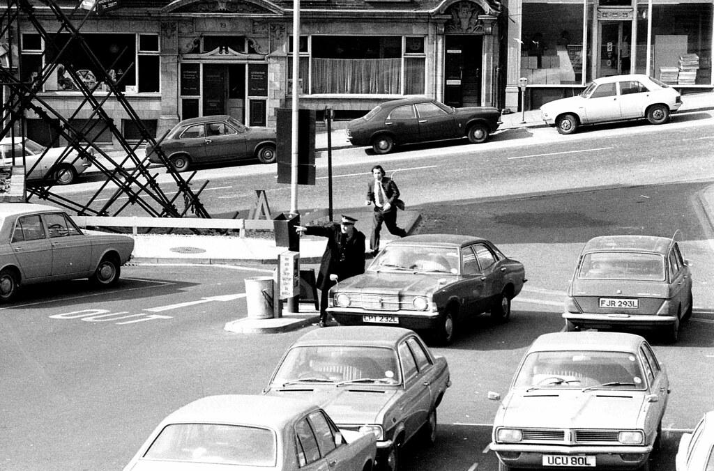Man runs away from Austin Allegro