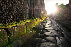 Streets of Pompeii (Rubicon Explorer) Tags: street sunset italy puddle moss ancient stones flare pompeii pompei