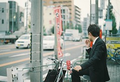 (bobby stokes) Tags: slr film bike bicycle japan japanese cigarette smoke natura smoking 1600 nagoya fujifilm analogue smoker salaryman  urbanlife fujicolor  natura1600 fujinatura1600 fujifilmnatura1600 fujicolornatura1600