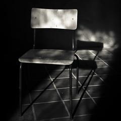 Chair shadow (manganite) Tags: light shadow bw white black tower digital germany dark square geotagged chair nikon europe tl perspective atmosphere monastery d200 nikkor dslr turm vignette kloster siegburg northrhinewestphalia 18200mmf3556 utatafeature manganite nikonstunninggallery date:year=2008 date:month=february date:day=10 geo:lat=50795651 geo:lon=7210851 format:orientation=square format:ratio=11