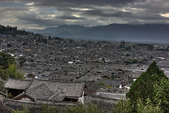 Lijiang Old Town from the Tower (Ray Devlin) Tags: world china old heritage stone buildings town site asia rooftops timber unesco peoples cobble lou wang yunnan cobbles quaint picturesque gu hdr lijiang province lanes dayan peoplesrepublicofchina padoga lijiangoldtown yunnanprovince wanggulupadoga unescoworldheritagesote