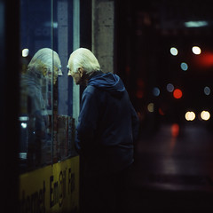 the face of another (memetic) Tags: street old city urban man reflection 120 6x6 face night mediumformat lights dof kodak bokeh tl melbourne flinders shopfront p6 pentaconsix sonnar 180mm epl 400x artlibre unsensored08exhibitedwork