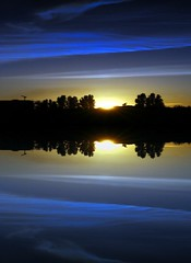 Lakeside (Heaven`s Gate (John)) Tags: blue sunset lake reflection nature silhouette river landscape topf50 creative dramatic atmosphere lakeside ely imagination fens cambridgeshire artisticexpression 50faves 10faves 25faves johndalkin heavensgatejohn anawesomeshot colorphotoaward