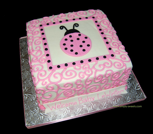 Pink and black ladybug themed baby shower cake and favors